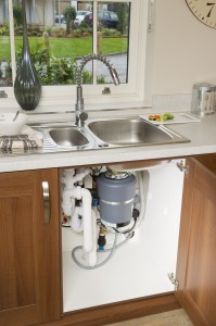 A food waste disposer under a kitchen sink